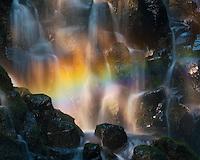 Rainbows and golden light illuminate this waterfall cascade in the Mt. Hood Wilderness, Oregon.