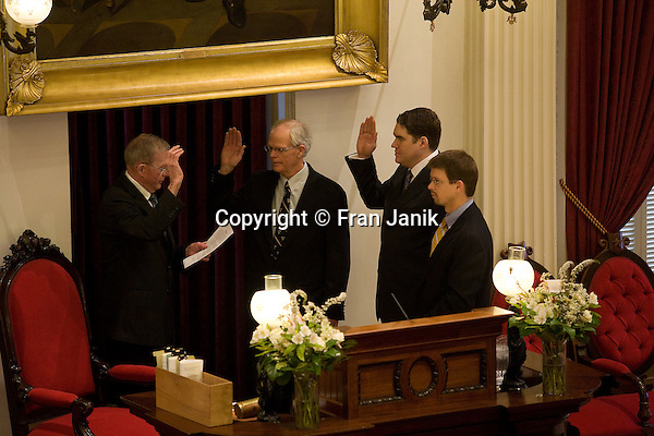 The speaker of the house Shap Smith read a letter form Governor James T. Douglas today in the well of the state house appointing Robert C. Krebs and Oliver K, Olsen to fill two vacancies in the General Assembly. As Shap looks on Robert C. Krebs and Oliver K. Olson are sworn in by the clerkof the house Don Milne.