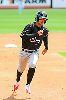 Quad Cities River Bandits shortstop Jonathan Arauz (22) rounds third base during a Midwest League game against the Wisconsin Timber Rattlers on June 27, 2017 at Fox Cities Stadium in Appleton, Wisconsin.  Quad Cities defeated Wisconsin 6-5. (Brad Krause/Four Seam Images)