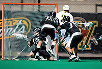 3 April 2010: University of Vermont Catamounts' Attacker Derek Lichtfuss, a Junior from Lutherville, MD, scores against goalie Jordan Marra of the Binghamton University Bearcats at Moulton Winder Field in Burlington, Vermont. The Catamounts defeated the visiting Bearcats 11-8 in Vermont's opening home game of the 2010 season. Mandatory Credit: Ed Wolfstein Photo