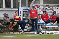 Essex players look on from the dugout area during Essex Eagles vs Sussex Sharks, Vitality Blast T20 Cricket at The Cloudfm County Ground on 15th June 2021