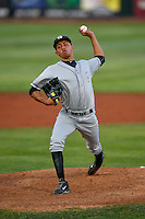 Grand Junction Rockies starting pitcher Luis Guzman (19) delivers a pitch to the plate against the Orem Owlz in Pioneer League action at Home of the Owlz on July 6, 2016 in Orem, Utah. The Rockies defeated the Owlz 5-4 in Game 2 of the double header.  (Stephen Smith/Four Seam Images)