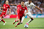 Thiago (l) of FC Bayern Munich battles for the ball with Carlos Henrique Casemiro of Real Madrid during their 2016-17 UEFA Champions League Quarter-finals second leg match between Real Madrid and FC Bayern Munich at the Estadio Santiago Bernabeu on 18 April 2017 in Madrid, Spain. Photo by Diego Gonzalez Souto / Power Sport Images