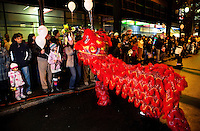 A Chinese dragon greets the crowd watching a parade during First Night Charlotte 2010. The family-friendly public event (no alcohol allowed) is an annual cultural New Year's Eve celebration held in downtown / uptown / Charlotte center city. Charlotte First Night - An Imagination Celebration brought together artists, musicians, dancers and more from across the country. The New Year's event is organized by Charlotte Center City Partners, which facilitates and promotes the economic and cultural development of this North Carolina urban core.