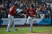 Mason Martin (23) of the Altoona Curve slaps hands with third base coach Miguel Perez (29) after hitting a home run against the Somerset Patriots at TD Bank Ballpark on July 24, 2021, in Somerset NJ. (Brian Westerholt/Four Seam Images)