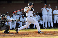 Third baseman Jake Beaver (11) of the University of South Carolina Upstate Spartans hits in a game against the Winthrop University Eagles on Wednesday, March 4, 2015, at Cleveland S. Harley Park in Spartanburg, South Carolina. Upstate won, 12-3. (Tom Priddy/Four Seam Images)