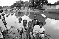 - Mozambique 1993, children in the shantytown of Barrio Mulene, at the periphery of Maputo<br /> <br /> - Mozambico 1993, bambini nella bidonville di Barrio Mulene, alla periferia di Maputo