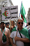Algerian protesters march in an anti-government demonstration in the capital Algiers on March 15, 2019.  Photo by Taher Boussoualim