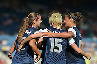 Glasgow, Scotland - July 25, 2012: Alex Morgan, Megan Rapinoe and Carli Lloyd celebrate the first of two goals by Alex Morgan in Glasgow, Scotland at the London Olympics