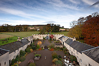 The courtyard is flanked by outbuildings that originally housed services such as the laundry, dairy, and bakehouse