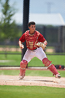 GCL Nationals catcher Geraldi Diaz (12) throws to first base during a Gulf Coast League game against the GCL Astros on August 9, 2019 at FITTEAM Ballpark of the Palm Beaches training complex in Palm Beach, Florida.  GCL Nationals defeated the GCL Astros 8-2.  (Mike Janes/Four Seam Images)