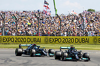 18th July 2021; Silverstone Circuit, Silverstone, Northamptonshire, England; Formula One British Grand Prix, Race Day; Mercedes AMG Petronas F1 Team driver Lewis Hamilton in his Mercedes F1 W12 ahead of his team mate Valtteri Bottas