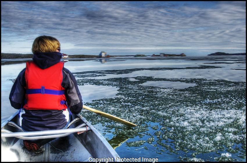 paddling through spring ice in Yellowknife Bay