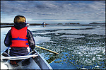 paddling through spring ice in Yellowknife Bay