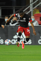 WASHINGTON, DC - MAY 13: Moses Nyeman #27 of D.C. United moves the ball during a game between Chicago Fire FC and D.C. United at Audi FIeld on May 13, 2021 in Washington, DC.