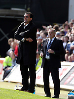 ATTENTION SPORTS PICTURE DESK<br /> Pictured L-R: Managers Roberto Martinez for Swansea and Dave (David) Jones for Cardiff watch on.<br /> Re: Coca Cola Championship, Cardiff City FC v Swansea City FC at Ninian Park, Cardiff, south Wales. Sunday 05 April 2009.<br /> Picture by D Legakis Photography / Athena Picture Agency, Swansea 07815441513