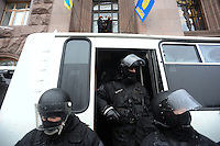 """Special police forces """"Berkut"""" during the failed assault on town hall. Kiev Ukraine.<br /> <br /> Protesters did not give up after the faint  attempt of evacuation performed by the police of the night before. Despite the adverse weather conditions,  they restored and rebuilt the complex structures of the  barricades under the snow in Maidan square. Kiev,  Ukraine."""