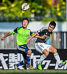 Kin Wai Sze of Wofoo Tai Po (L) competes for the ball with Pak Hang Chan of Sun Pegasus FC (R) during the HKFA Premier League between Wofoo Tai Po vs Sun Pegasus at the Tai Po Sports Ground on 22 November 2014 in Hong Kong, China. Photo by Aitor Alcalde / Power Sport Images