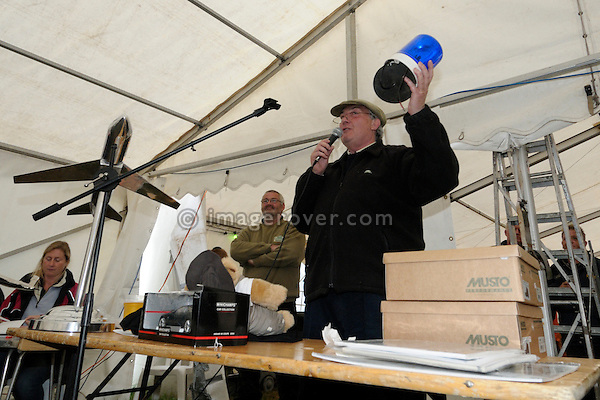 Richard Beddall being the auctioneer at the famous saturday night Dunsfold Collection auction. Dunsfold Collection of Land Rovers Open Day 2011, Dunsfold, Surrey, UK. --- No releases available, but releases may not be necessary for certain uses. Automotive trademarks are the property of the trademark holder, authorization may be needed for some uses.