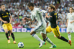 Raphael Varane (l) of Real Madrid fights for the ball with Antoine Griezmann of Atletico de Madrid during their 2016-17 UEFA Champions League Semifinals 1st leg match between Real Madrid and Atletico de Madrid at the Estadio Santiago Bernabeu on 02 May 2017 in Madrid, Spain. Photo by Diego Gonzalez Souto / Power Sport Images