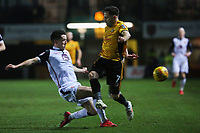 Robbie Willmott of Newport County is tackled by Aaron McGowan of Morecambe during the Sky Bet League Two match between Newport County and Morcambe at Rodney Parade, Newport, Wales, UK. 23 January 2018