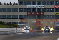 May 21, 2016; Topeka, KS, USA; NHRA funny car driver Jack Wyatt (left) races alongside Brian Stewart during qualifying for the Kansas Nationals at Heartland Park Topeka. Mandatory Credit: Mark J. Rebilas-USA TODAY Sports