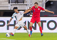 WASHINGTON, DC - OCTOBER 11: Rolando Abreu #7 of Cuba fights for the ball with Jordan Morris #11 of the United States during a game between Cuba and USMNT at Audi Field on October 11, 2019 in Washington, DC.