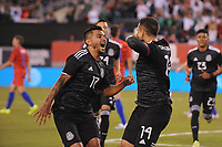 EAST RUTHERFORD, NJ - SEPTEMBER 7: Javier Hernandez #14 of Mexico celebrates his score with Jesus Manuel Corona #17 of Mexico during a game between Mexico and USMNT at MetLife Stadium on September 6, 2019 in East Rutherford, New Jersey.