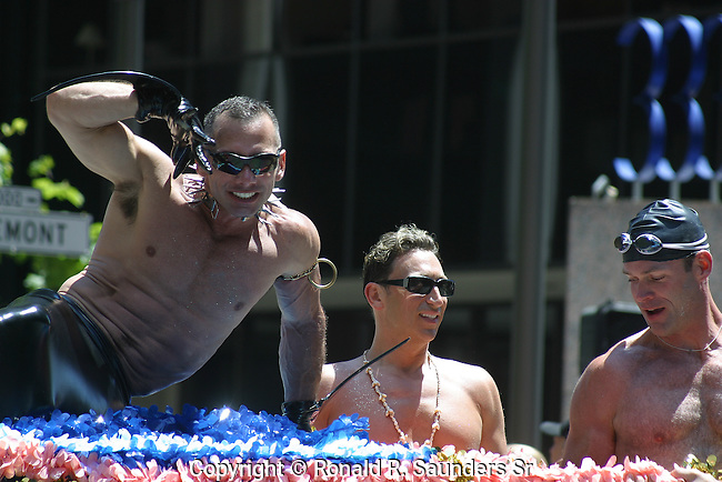 GAY MAN RIDES ON FLOAT AS OTHERS MARCH ALONGSIDE