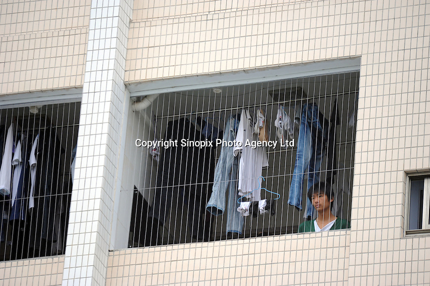 Workers in the Weilong dormitory belonging to Foxconn, Longhua, Shenzhen which has been fitted with steel wire mesh to stop workers jumping from the windows. The Foxconn factory in Longhua, near Shenzhen. Foxconn is Apple's major supplier and the Shenzhen plant employ 420,000 workers. There have been a rash of at leat 12 suicides in 2010 believed to be due to harsh management practices..