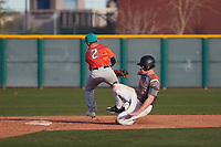 David Wilson (16) of Akins High School in Austin, Texas slides into second base behind Norman Leon (2) of Evergreen Valley High School in San Jose, California during the Baseball Factory All-America Pre-Season Tournament, powered by Under Armour, on January 14, 2018 at Sloan Park Complex in Mesa, Arizona.  (Freek Bouw/Four Seam Images)