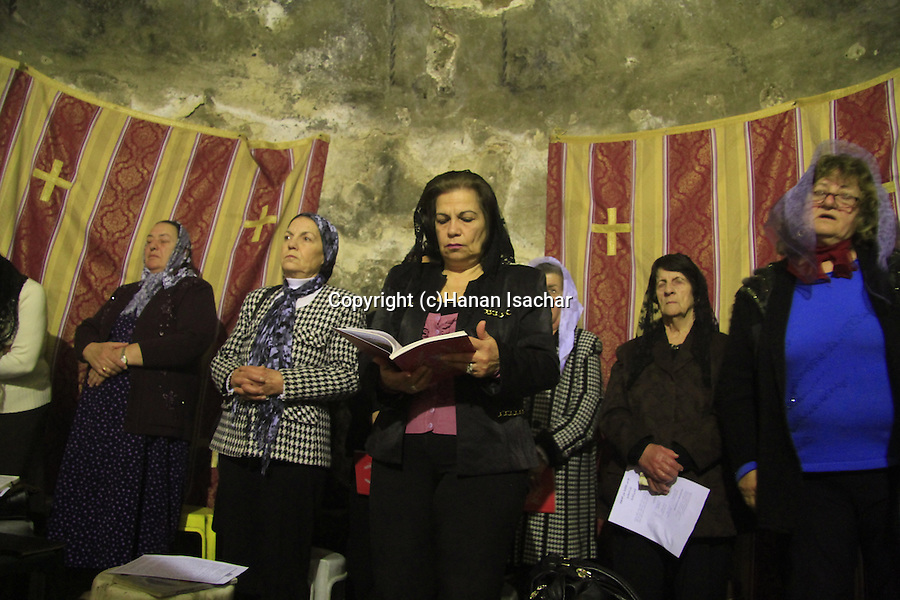 Israel, Jerusalem Old City, a prayer at the Syrian Orthodox Chapel of St. Joseph of Arimathea and St. Nicodemus in the Church of the Holy Sepulchre