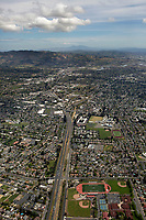 aerial photograph of the City of Napa, California from the north toward downtown with Highway 29 in the foreground; the Napa River and Mount Diablo in the background