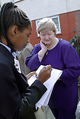 A tenant requests a repair from a Haringey Council housing officer on Coldfall Estate, Tottenham.