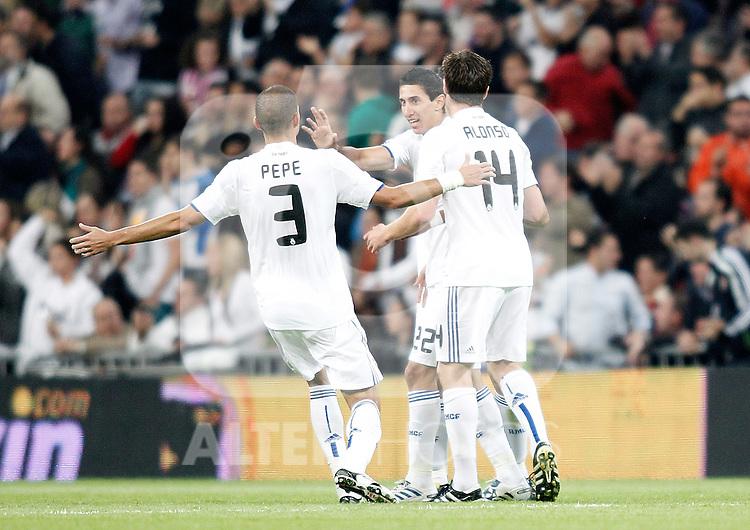 Real Madrid's Pepe celebrates with Angel Di Maria and Xabi Alonso during La Liga match. October 23, 2010. (ALTERPHOTOS/Alvaro Hernandez)