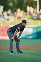Umpire John Libka handles the calls on the bases during the game between the Salt Lake Bees and the New Orleans Baby Cakes at Smith's Ballpark on June 11, 2018 in Salt Lake City, Utah. New Orleans defeated Salt Lake 6-5.  (Stephen Smith/Four Seam Images)