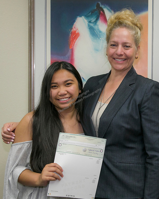 Mae Sison, left, and Board Member Tricia Gallenbeck during the Nevada Women's Fund Scholarship distribution, June 20, 2019.