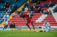BLACKBURN, ENGLAND - JANUARY 24:   Bafetibis Gomis of Swansea City eyes up the ball during the FA Cup Fourth Round match between Blackburn Rovers and Swansea City at Ewood park on January 24, 2015 in Blackburn, England.  (Photo by Athena Pictures/Getty Images)