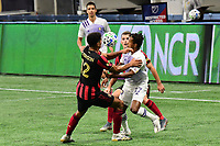 ATLANTA, GA - AUGUST 29: Miles Robinson #12 of Atlanta United and Nani #17 of Orlando City wrestle for possession of the ball during a game between Orlando City SC and Atlanta United FC at Marecedes-Benz Stadium on August 29, 2020 in Atlanta, Georgia.