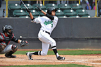 Clinton LumberKings designated hitter Dimas Ojeda (33) swings during a game against the Lansing Lugnuts at Ashford University Field on May 9, 2017 in Clinton, Iowa.  The Lugnuts won 11-6.  (Dennis Hubbard/Four Seam Images)