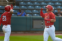 Springfield Cardinals Delvin Perez (23) congratulates Nolan Gorman (28) after hitting a home run during a game against the Arkansas Travelers on June 8, 2021 at Hammons Field in Springfield, Missouri.  (Travis Berg/Four Seam Images)