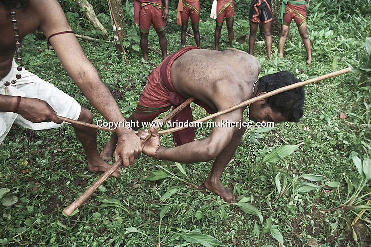 Teacher showing his students how to lock the oponnent with a stick in Kalaripayattu, the ancient martial art form of India, Cheranaloor, Kerala, India