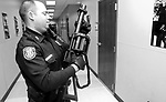 """Memphis Police Officer Lt. Terry Lyons with the Crisis Intervention Team prepares his SL6 Six Shot Semi-automatic Projectile Launcher. After you get passed the intimidation factor of it, the gun actually shoots rubber bullets, about the size of a baby's fist. """"We use these for mentally challenged individuals so we wont have to shoot them, just subdue them"""" Lyons said."""
