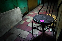 A pink powder box, belonging to a sex worker, lies on a chair in front of a room where sexual services are offered to clients in San Salvador, El Salvador, 19 February 2014. Although prostitution is not legal in El Salvador, dozens of street sex workers, wearing provocative miniskirts, hang out in the dirty streets close to the capital's historic center. Sex workers of all ages are seen on the streets but a significant part of them are single mothers abandoned by their male partners. Due to the absence of state social programs, they often seek solutions to their economic problems in sex work. The environment of street sex business is strongly competitive and dangerous, closely tied to the criminal networks (street gangs) that demand extortion payments. Therefore, sex workers employ any tool at their disposal to struggle hard, either with their fellow workers, with violent clients or with gang members who operate in the harsh world of street prostitution.