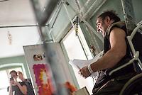 """Pressekonferenz zur Raeumung des kreuzberger Infoladen """"M99 – Gemischtwarenladen mit Revolutionsbedarf"""".<br /> Der Betreiber des Infoladen M99, Hans-Georg """"HG"""" Lindenau berichtete am Donnerstag den 4. August 2016 auf der Pressekonferenz, dass der Anwalt des Hauseigentuemers Frederick Hellmann nach etlichen Monaten auf ein Angebot des Betreibers zur Wohnungssuche und einer neuen Oertlichkeit seines Infoladen eingegangen ist. Der Eigentuemer hat ueber seinen Anwalt jetzt erklaert, dass er vor der Abgeordnetenhauswahl im September von einer polizeilichen Raeumung absehen werde.<br /> Im Bild: HG Lindenau sitz im Rollstuhl in seiner bereits leeren Wohnung ueber seinem Laden und spricht mit Medienvertretern.<br /> 4.8.2016, Berlin<br /> Copyright: Christian-Ditsch.de<br /> [Inhaltsveraendernde Manipulation des Fotos nur nach ausdruecklicher Genehmigung des Fotografen. Vereinbarungen ueber Abtretung von Persoenlichkeitsrechten/Model Release der abgebildeten Person/Personen liegen nicht vor. NO MODEL RELEASE! Nur fuer Redaktionelle Zwecke. Don't publish without copyright Christian-Ditsch.de, Veroeffentlichung nur mit Fotografennennung, sowie gegen Honorar, MwSt. und Beleg. Konto: I N G - D i B a, IBAN DE58500105175400192269, BIC INGDDEFFXXX, Kontakt: post@christian-ditsch.de<br /> Bei der Bearbeitung der Dateiinformationen darf die Urheberkennzeichnung in den EXIF- und  IPTC-Daten nicht entfernt werden, diese sind in digitalen Medien nach §95c UrhG rechtlich geschuetzt. Der Urhebervermerk wird gemaess §13 UrhG verlangt.]"""
