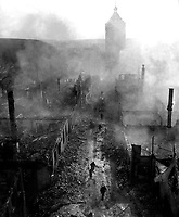 Infantrymen of the 255th Inf. Regt. move down a street in Waldenburg to hunt out the Hun after a recent raid by 63rd Division.  April 16, 1945.  2d Lt. Jacob Harris. (Army)<br /> NARA FILE #:  111-SC-205778<br /> WAR & CONFLICT BOOK #:  1095