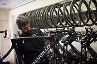 Team SKY mechanic David Fernandez at work on a new bike <br /> <br /> stage 21: Alcala de Henares - Madrid (98km)<br /> 2015 Vuelta à Espana