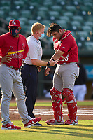Palm Beach Cardinals manager Jose Leon (left) and Athletic Trainer Chris Walsh check on catcher Carlos Soto (35) after an injury during a game against the Jupiter Hammerheads on May 11, 2021 at Roger Dean Chevrolet Stadium in Jupiter, Florida.  (Mike Janes/Four Seam Images)