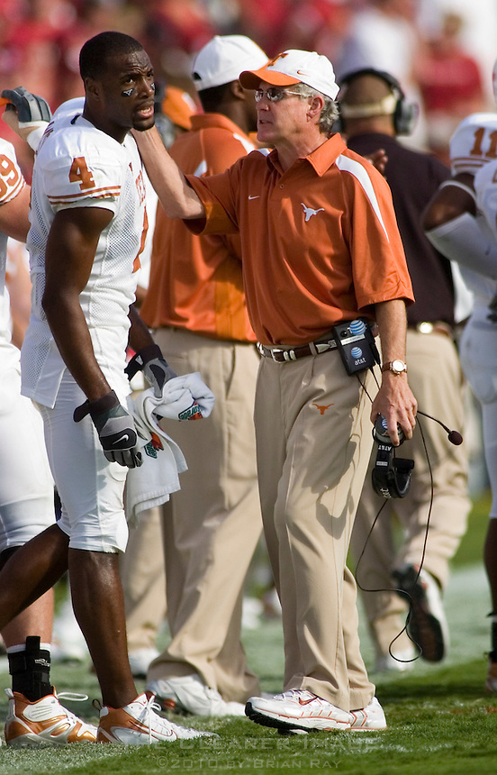 07 October 2006: Texas head coach Mack Brown, center, congratulates receiver Limas Sweed (#4) during the Longhorns 28-10 victory over the University of Oklahoma Sooners at the Cotton Bowl in Dallas, TX.