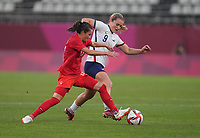 KASHIMA, JAPAN - AUGUST 2: Lindsey Horan #9 of the United States battles for the ball with Jessie Fleming #17 of Canada during a game between Canada and USWNT at Kashima Soccer Stadium on August 2, 2021 in Kashima, Japan.